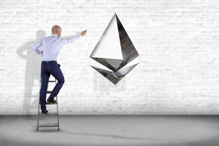 Businessman in front of wall with Ethereum crypto currency sign flying around network connection - 3d render