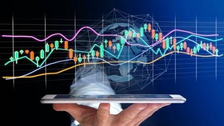 View of a Businessman usng a smartphone with a 3d render Stock exchange trading data information display on a futuristic interface