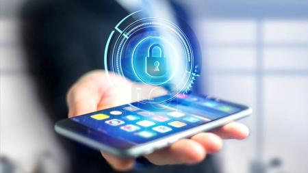 Businessman using smartphone with Shinny technologic locker security button  - 3d render