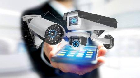 Photo pour Vue d'un homme d'affaires utilisant un smartphone avec système de caméra de sécurité et connexion réseau - image libre de droit