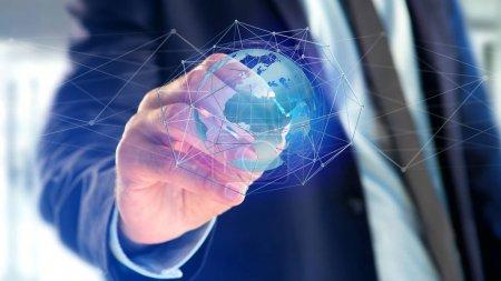 Foto de Vista del empresario sosteniendo conectado red sobre concepto de globo de tierra en interfaz futurista - Imagen libre de derechos
