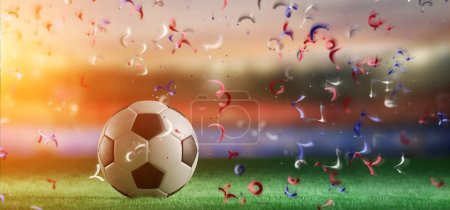 View of football ball on field of world cup stadium with streamers