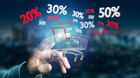 Red and white trolley and sales discounts over male hand
