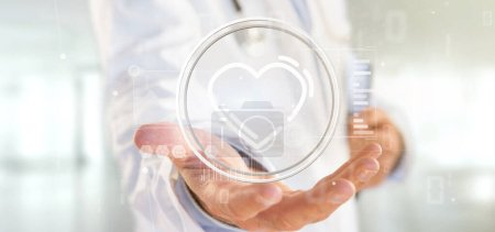 Photo for View of a Doctor holding a heart icon surrounded by data - Royalty Free Image