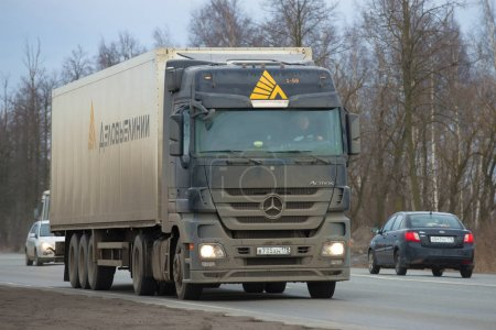 """The auto train of the transportation expeditionary company """"Business Lines"""" with the drive truck """"Mercedes Aktros 1841"""" on the roud M-10 close up"""