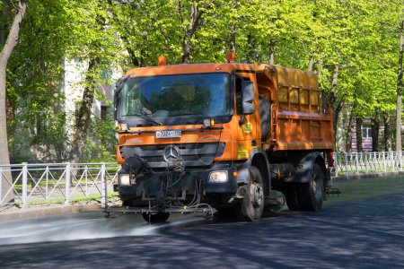 Municipal multifunctional truck `Mercedes Actros` on cleaning the streets. Saint-Petersburg