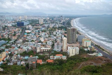 A view of the modern Vung Tau from Nho mount  overcast cloudy day. Vietnam