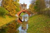 Cross bridge in the autumn landscape. The Golden Autumn in Tsarskoe Selo