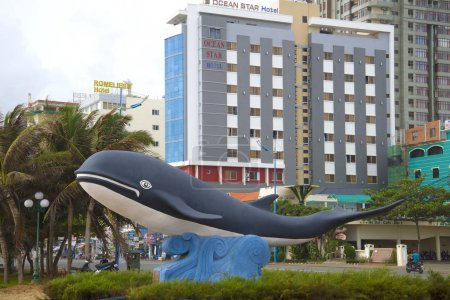 VUNG TAU, VIETNAM - DECEMBER 22, 2015: A city sculpture of a whale against the background of modern hotels