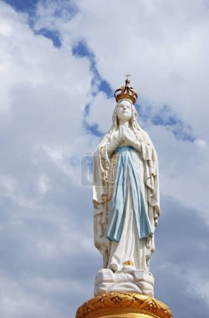 Our Lady, Virgin Mary, Mother of God in cloud sky