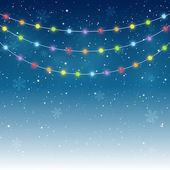 Color Christmas light on starry background