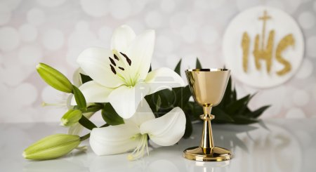 Symbol of christian religion and a golden chalice