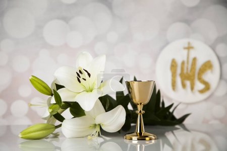 Holy communion a golden chalice with grapes