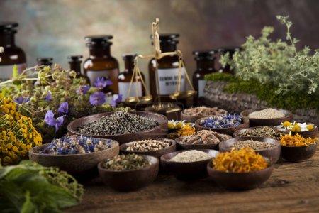 Foto de Herbal medicine on wooden desk background, alternative medicine - Imagen libre de derechos