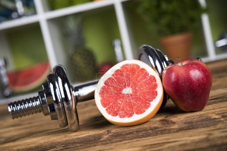 dumbbells and fresh fruits