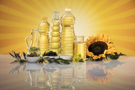 Photo for Healthy oil from sunflower, olive, rapeseed oil. Cooking oils in bottle - Royalty Free Image