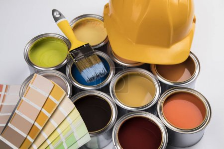 Photo for Tin metal cans with color paint and paintbrush - Royalty Free Image