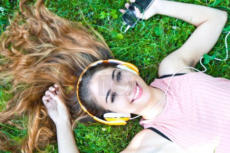Girl listening to music streaming