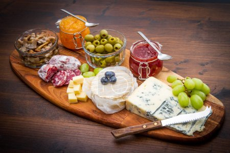 board with cheese and jams