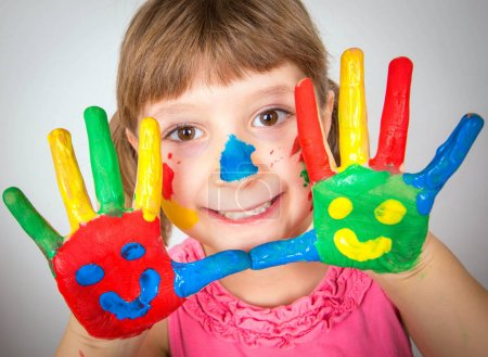 Photo for Smiling little girl with hands painted in colorful paints - Royalty Free Image