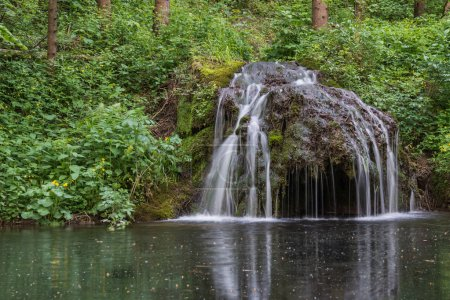 A beautiful landscape, filled with streams, waterf...