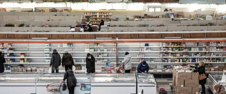 Photo for Kyiv, Ukraine - Mar. 23, 2020: Buyers in a large grocery shopping center in Kiev buy essential goods during the coronavirus pandemic - Royalty Free Image