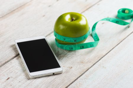 Blank smartphone with green apple