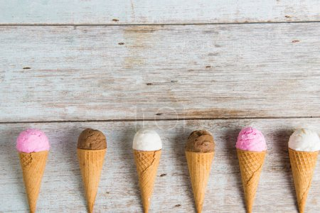 various ice creams on wooden background
