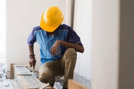 Contruction worker laying bricks