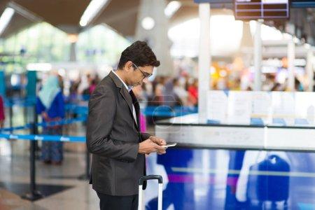 man checking airport schedule