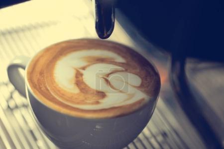 Barista making art on coffee
