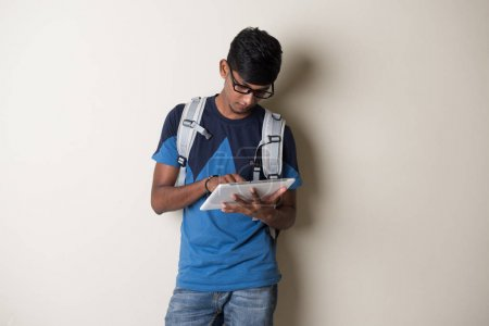 Indian young man with tablet computer