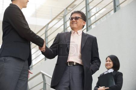 Photo for Asian team business meeting in front of modern office - Royalty Free Image