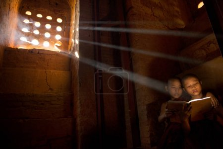 monks reading in monastry in sunlight rays