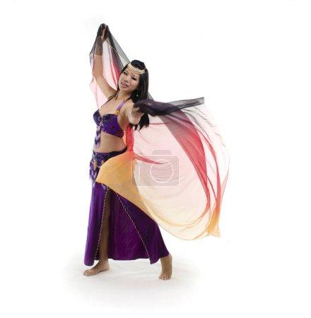 asian belly dancer oerforming in purple costume