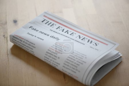 Photo for Fake news paper on table - Royalty Free Image