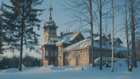 Beautiful traditional snow-covered russian cottage - terem in a forest.