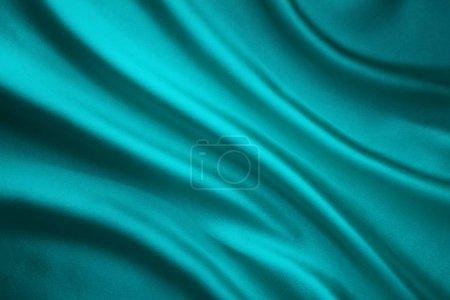 Photo pour Tissu ondulant le fond de soie, tissu de satin de sarcelle froissé en forme d'onde - image libre de droit