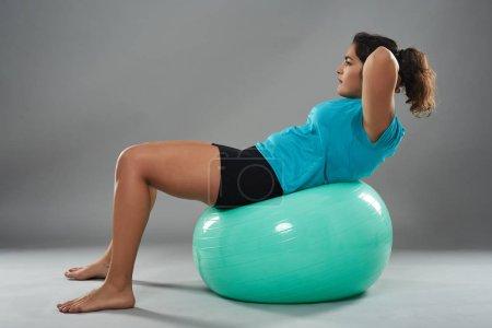 Woman on gym ball