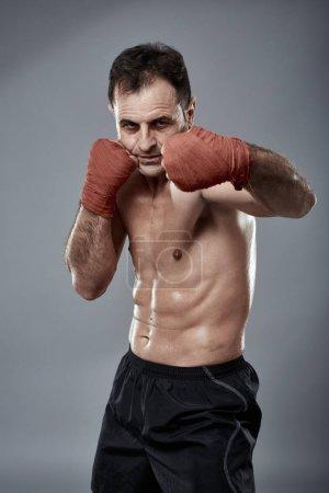 Kickbox fighter in postures