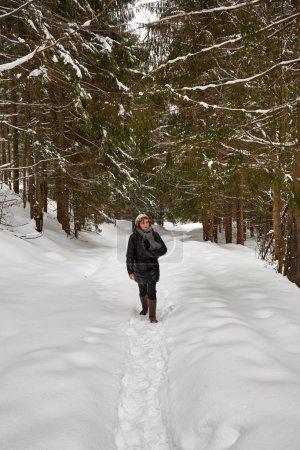 Tourist woman hiking with camera