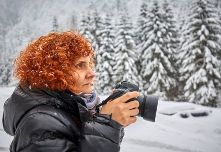 woman with camera taking winter photos
