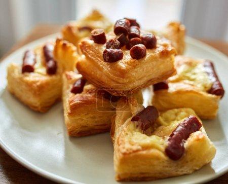 Pastry with sausages and cheese