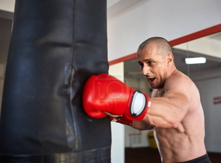 Boxer with heavy bag