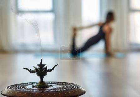 Yoga practitioner in blurred background