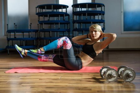 Fitness woman doing abs workout