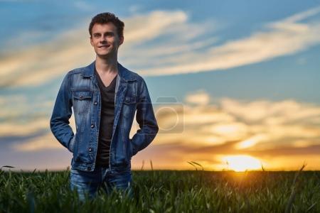 teenager in wheat field