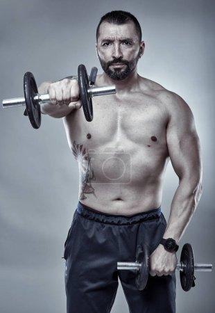 Fitness trainer doing shoulder workout