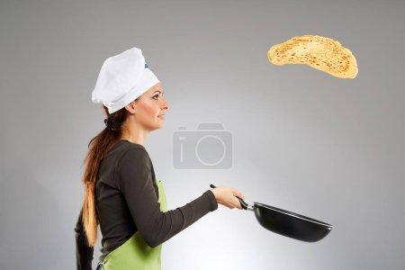 Woman cook flipping pancake
