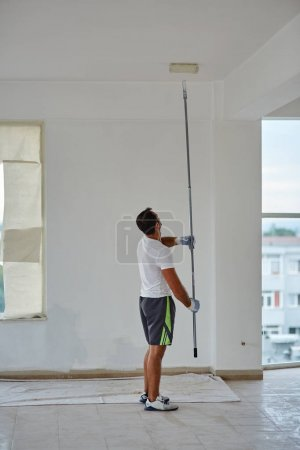 Worker painting walls